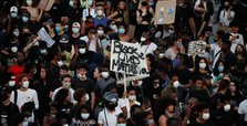 Thousands rally in Paris to condemn police killings of black men