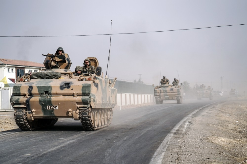 Turkish army tanks and armored personnel carriers move toward the Syrian border, Karkamu0131u015f, to support Free Syrian Army forces in the fight against Daish, Aug. 25, 2016.