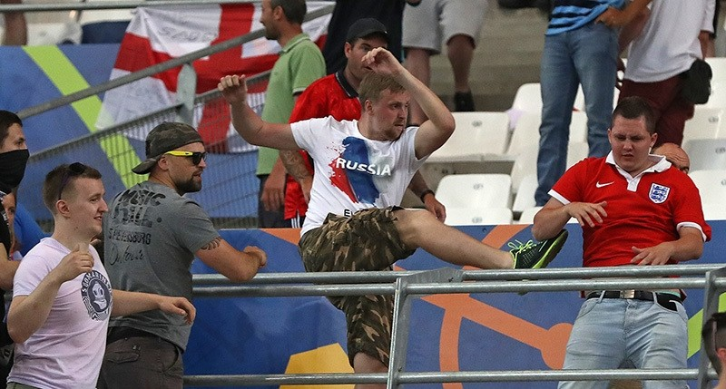 Russian supporters attack an England fan at the end of the Euro 2016 Group B soccer match between England and Russia, at the Velodrome stadium in Marseille, France. (AP Photo)