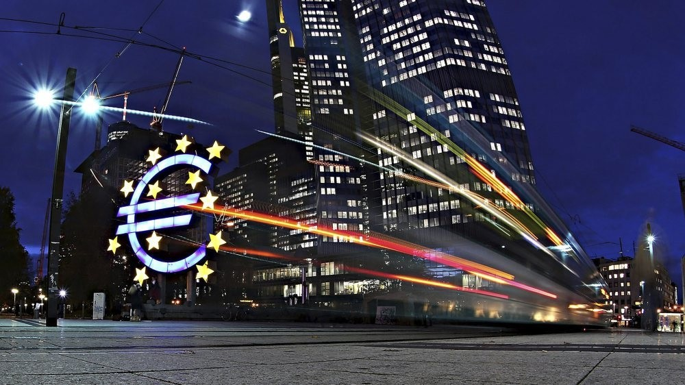 The giant Euro symbol stands illuminated outside the headquarters of European Central Bank (ECB)
