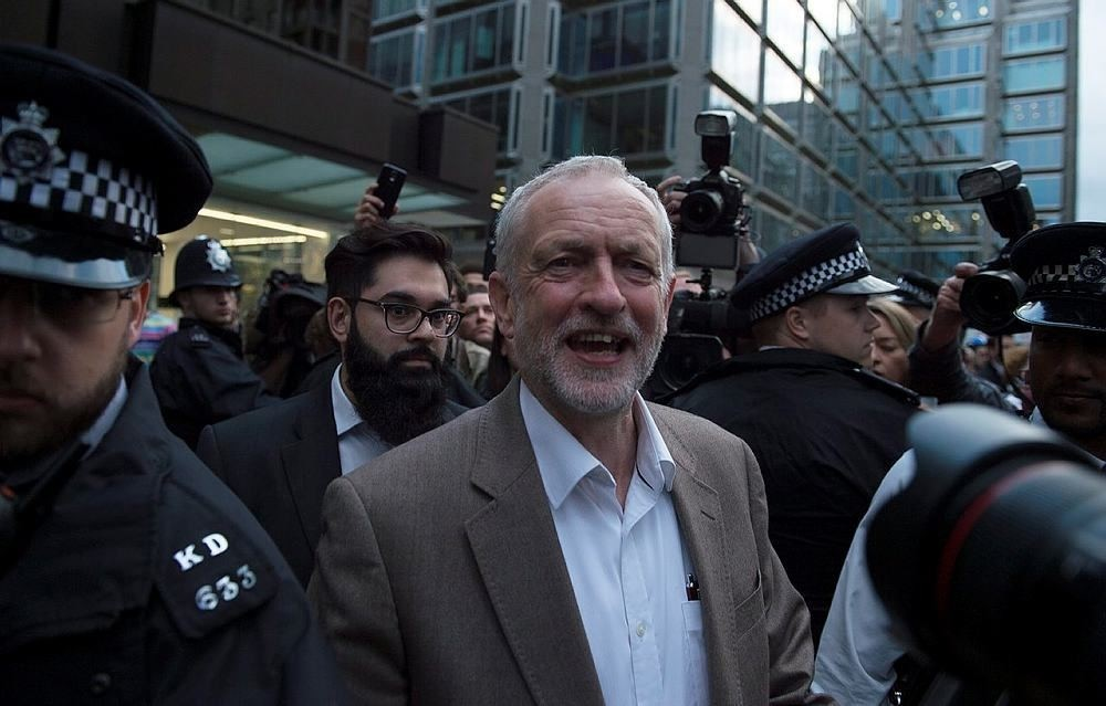 Leader of the Labour party Jeremy Corbyn (C) leaves the Labour Party Headquarters in London, Britain, 12 July 2016. (EPA Photo)