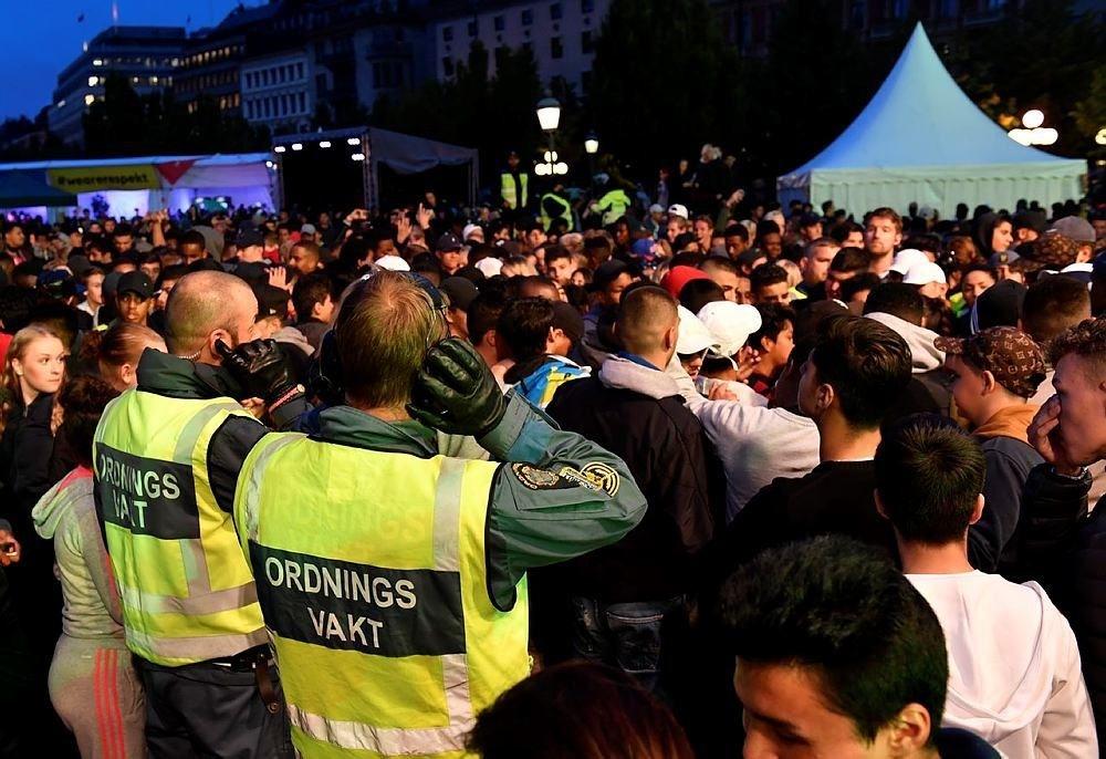 Security staff survey the scene at the ,We are Stockholm, festival in central Stockholm, Sweden, Thursday Aug. 18, 2016. (TT via AP)