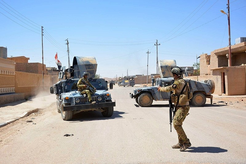 Iraqi government forces monitor a street on May 19, 2016 in the western town of Rutba after they recaptured it from the Daesh group. (AP Photo)
