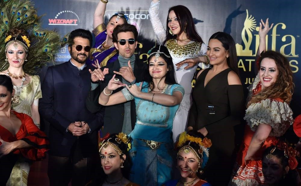 Indian actors Anil Kapoor (2ndL), Hrithik Roshan (3rdL) and Sonakshi Sinha (2ndR) pose with dancers before a press conference held to present the Bollywood Oscars in Madrid on March 14.