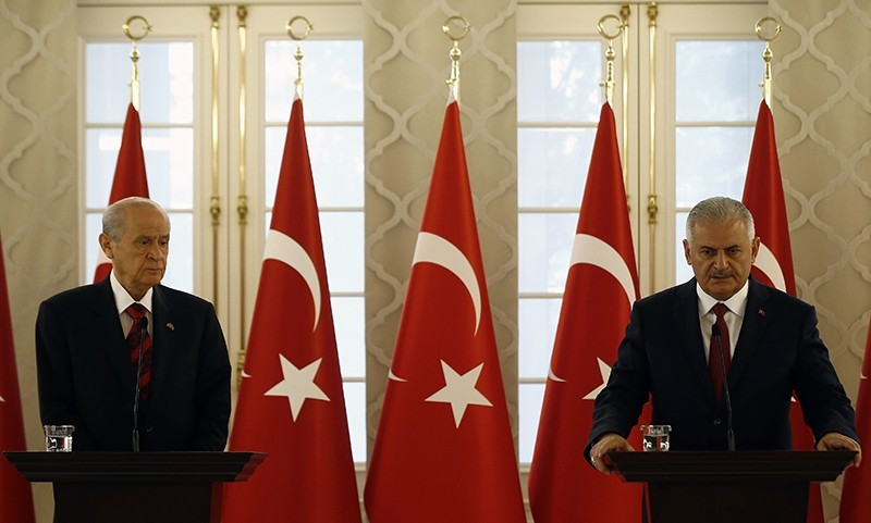 MHP's Chairman Devlet Bahu00e7eli (Left) at a press conference following a meeting with Prime Minister Binali Yu0131ldu0131ru0131m (Right) in Ankara on July 19, 2016 (AA Photo)