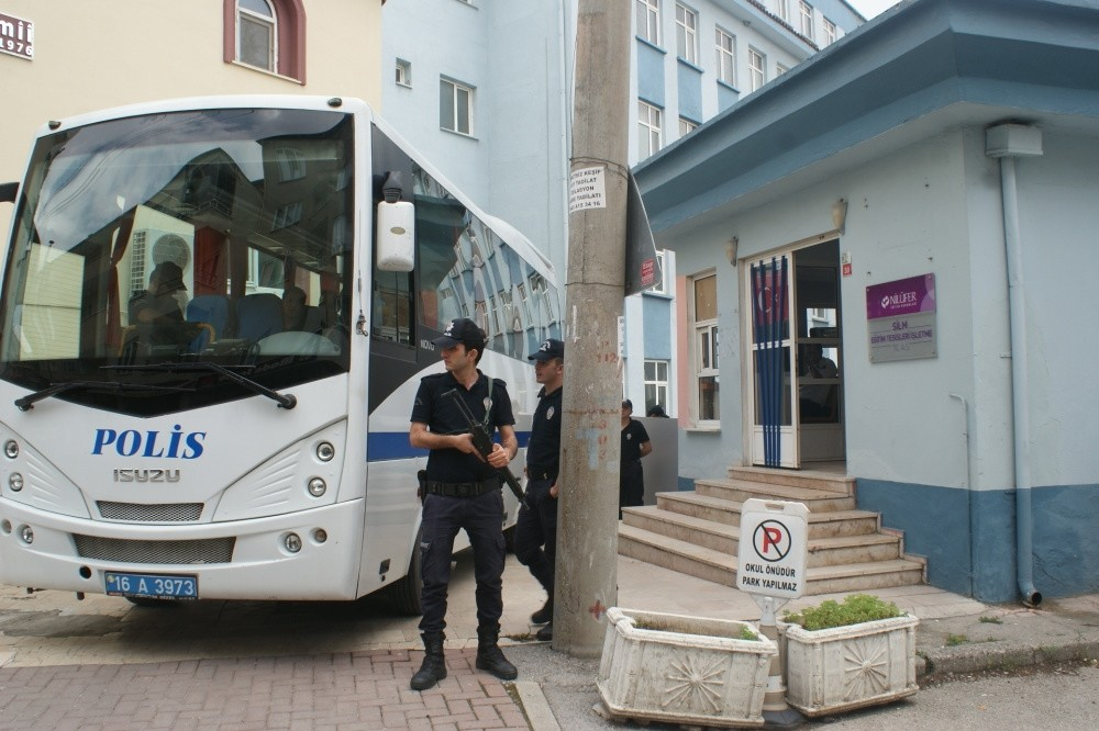 Police officers stand guard outside a Gu00fclen-linked school in the city of Bursa. The schools have been scrutinized since 2013 for their links to the Gu00fclenist Terror Organization.