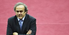 Platini says cleared by Swiss authorities, plans return