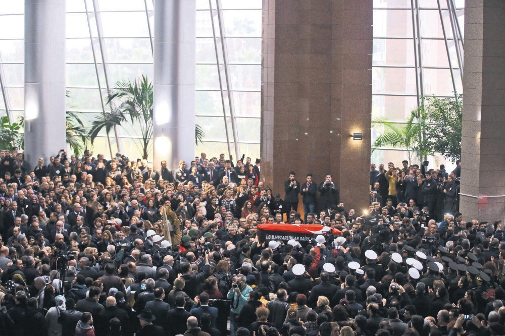 Hundreds attended the funeral ceremony for Fethi Sekin and Musa Can, two victims of the attack, at the courthouse they worked. (AFP)
