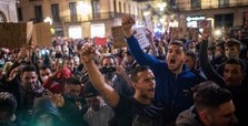 Protesters in Spain clash with police over curfew