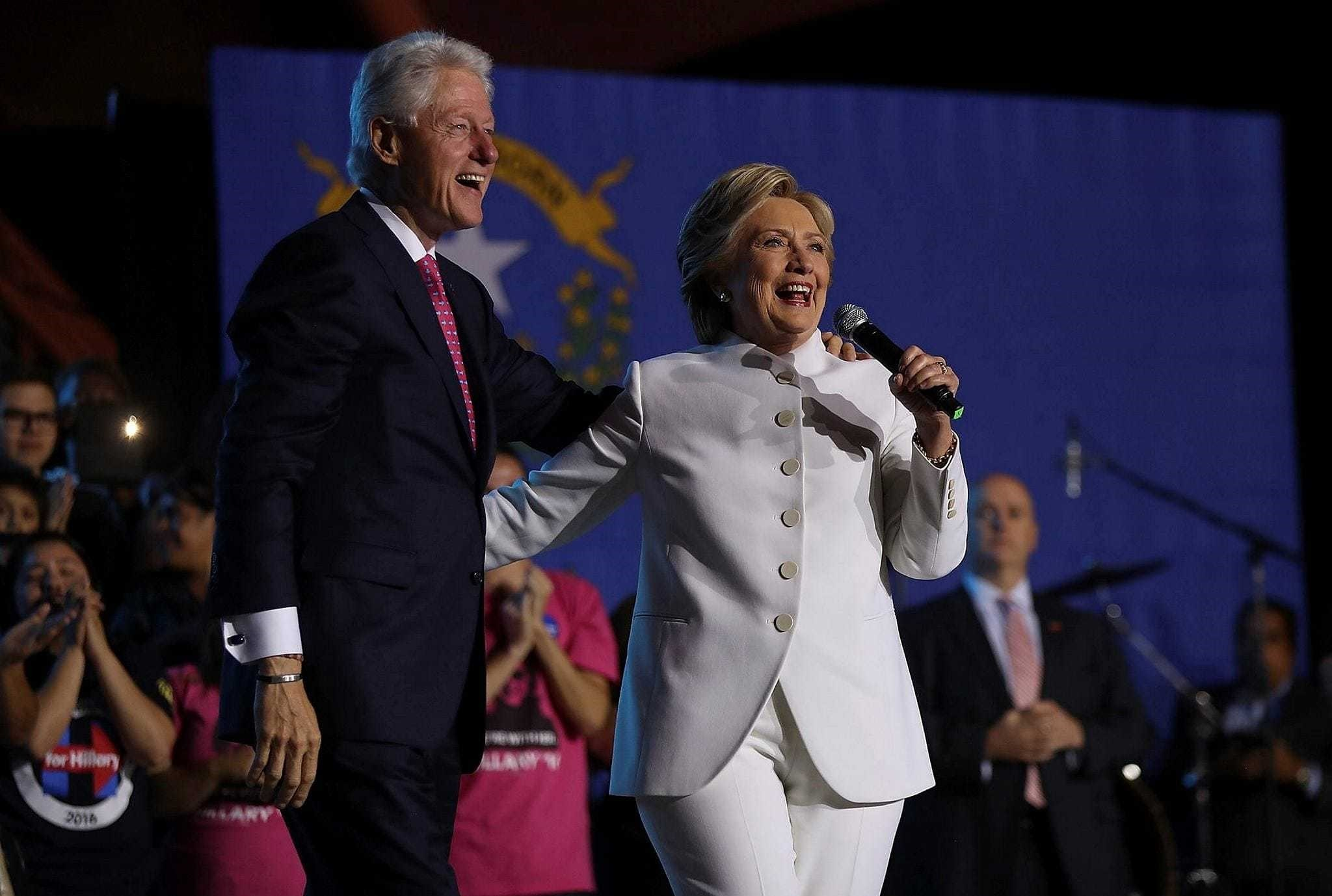 Democratic presidential nominee Hillary Clinton and her husband former U.S. President Bill Clinton speak during a debate watch party on Oct. 19.