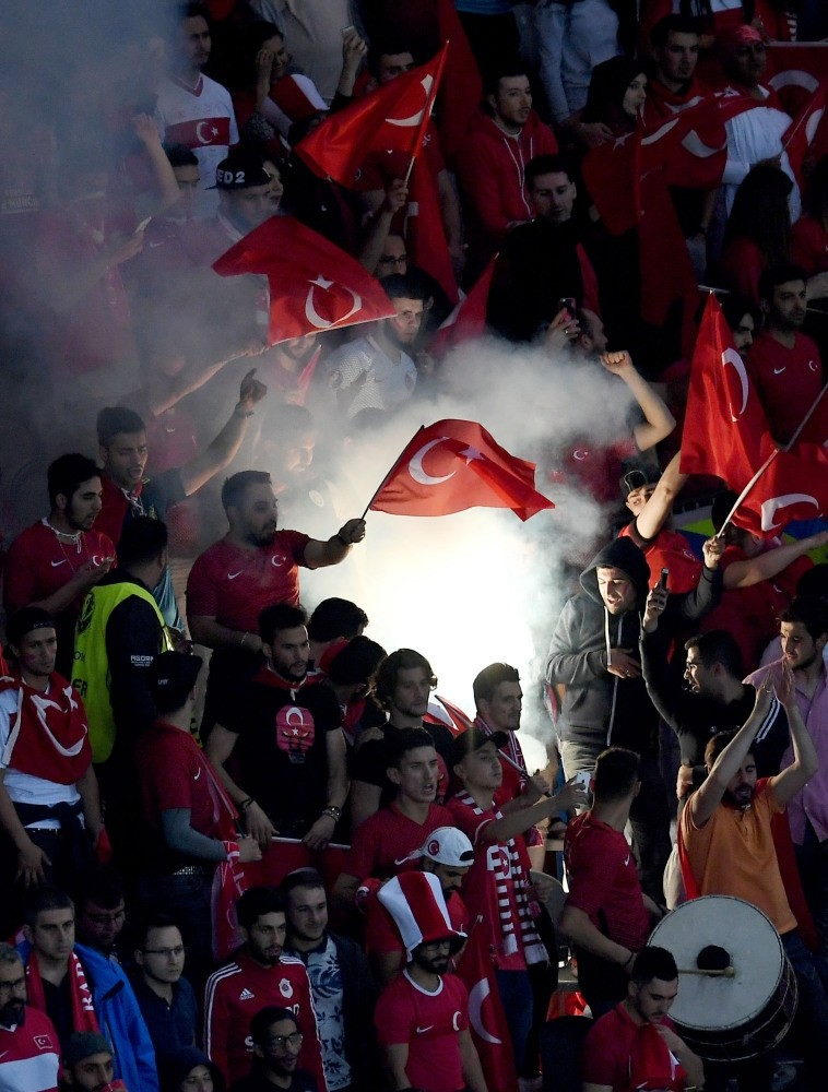 Supporters of Turkey light a flare during UEFA EURO 2016 group D preliminary round match between Czech Republic & Turkey at Stade Bollaert-Delelis in Lens, France, on Tuesday. World sports market is expected to reach $100 billion by 2018.