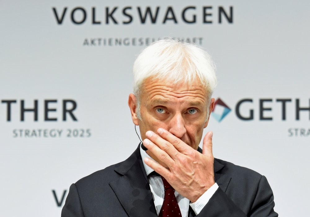 Volkswagen CEO Matthias Mueller wipes his nose as he addresses a news conference at Volkswagenu2019s headquarters in Wolfsburg.