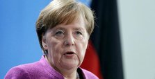 Merkel defends Germany's trade surplus