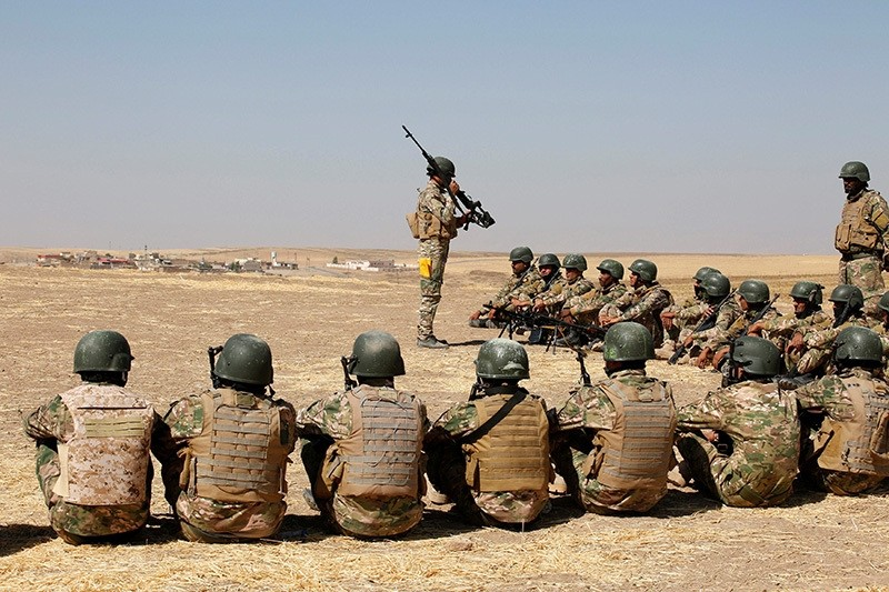 Fighters from predominantly Sunni Arab forces take part in a training session before the upcoming battle to recapture Mosul in Bashiqa, October 6, 2016. Picture taken October 6, 2016. (Reuters Photo)