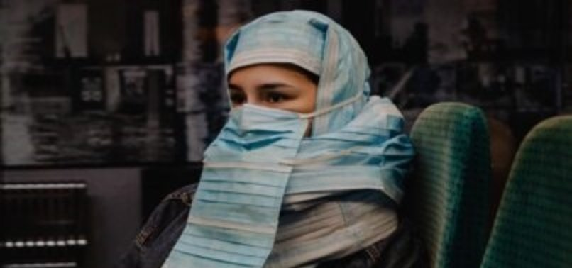 TURKISH ARTIST PROTEST BURQA BAN WITH SURGICAL MASKS