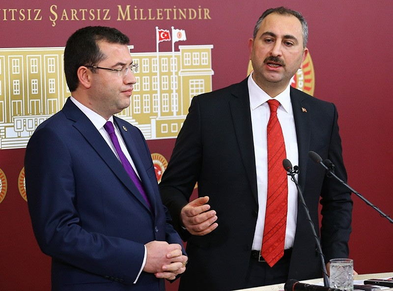MHP deputy Parsak (L) and AK Party deputy Gu00fcl hold a press conference on constitutional reform draft in Turkey's Parliament. (AA Photo)