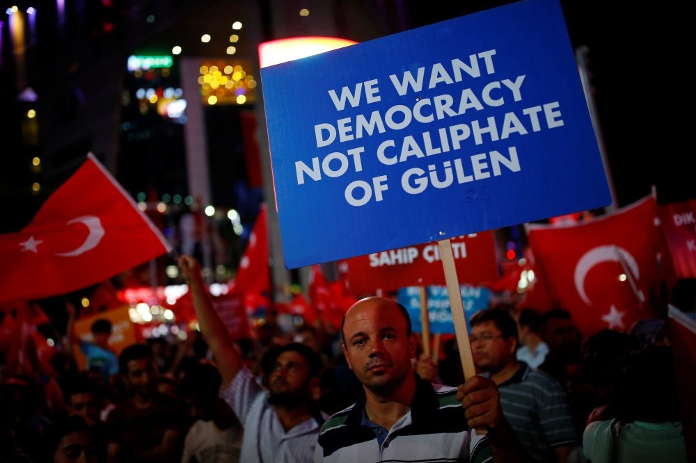 A man holding a banner at a gathering of the people in solidarity night after night since the July 15 coup attempt in central Ankara, July 27.