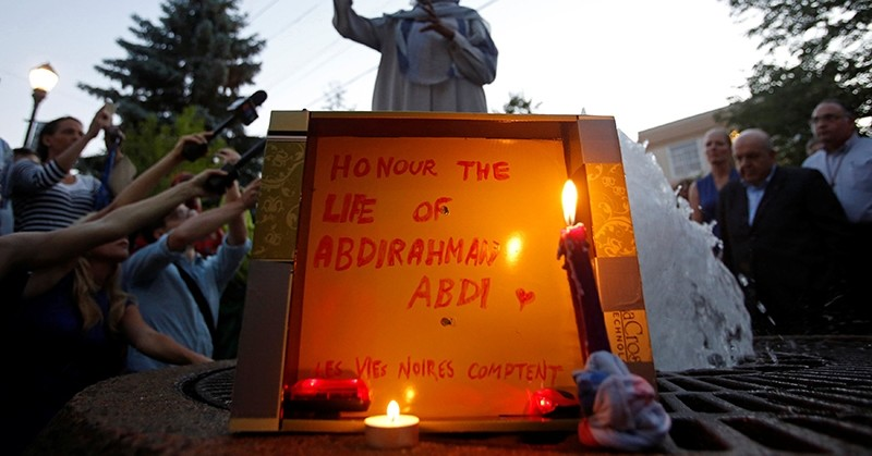 woman speaks during a vigil for Abdirahman Abdi, a Somali immigrant to Canada who died after being hospitalized in critical condition following his arrest by Canadian police, in Ottawa (Reuters Photo)