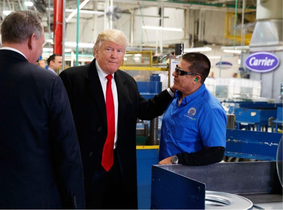 President-elect Donald Trump talks with workers during a visit to the Carrier factory, Thursday in Indianapolis.