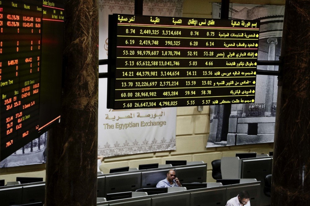 Egyptian traders work on the floor of the stock market in Cairo.