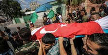 Palestinian martyr buried wrapped in Turkish flag