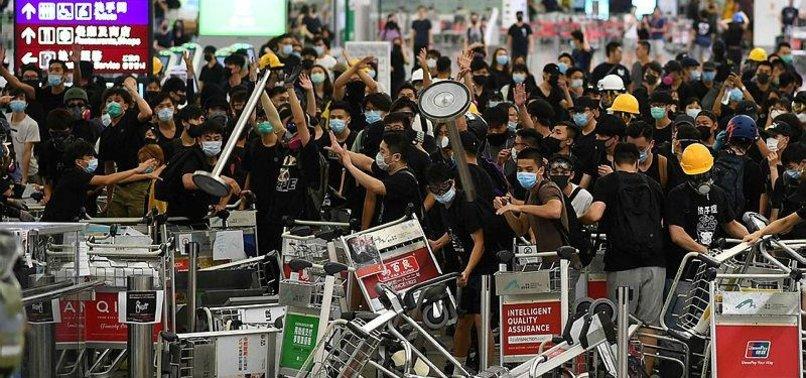 CHINA SLAMS HK AIRPORT PROTESTERS AS TERRORIST-LIKE