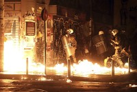 Greek riot police used tear gas and stun grenades in central Athens Tuesday to disperse about 3,000 left-wing marchers protesting a visit by President Barack Obama, after they tried to enter an...