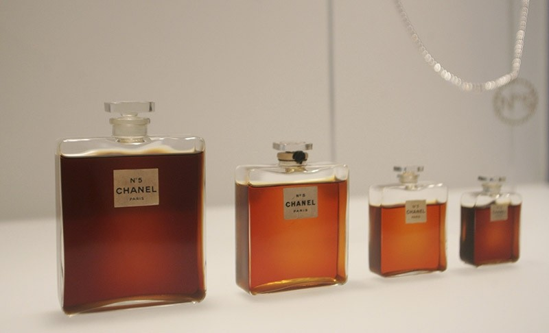 Bottles of Chanel No. 5 perfume are displayed at the Metropolitan Museum of Art's Costume Institute exhibit in New York, 2 May 2005. (AP Photo)