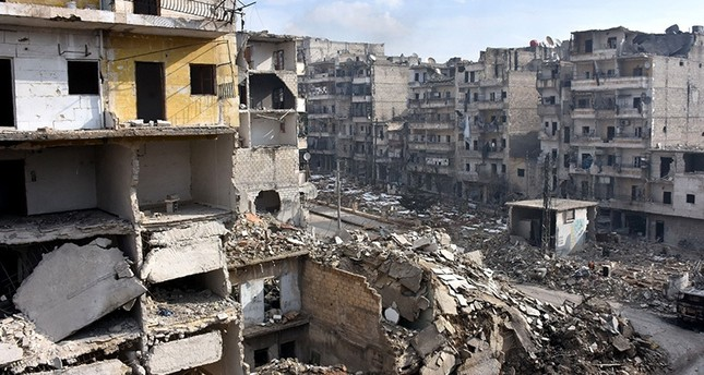 A picture shows destruction in the former rebel-held Sukkari district in the northern city of Aleppo on December 23, 2016 (AFP Photo)