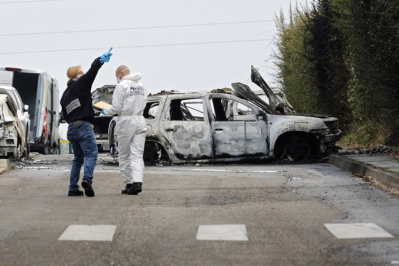 Police officers investigate on the highway where thieves rob an armored truck loaded with gold, Monday Dec. 12, 2016 in Dardilly, near Lyon, central France. (AP Photo)
