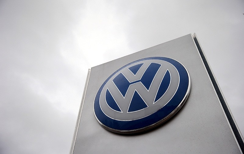 A VW sign is seen outside a Volkswagen dealership in London, Britain. (Reuters Photo)