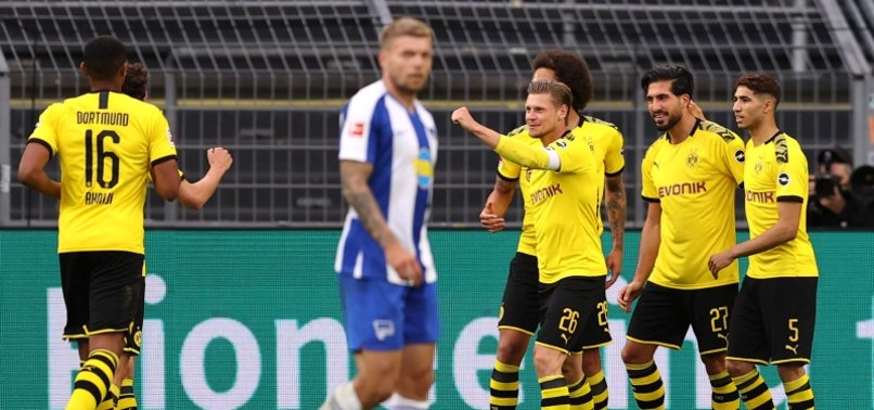 BORUSSIA DORTMUND BEAT HERTHA TO MAINTAIN FAINT TITLE HOPES