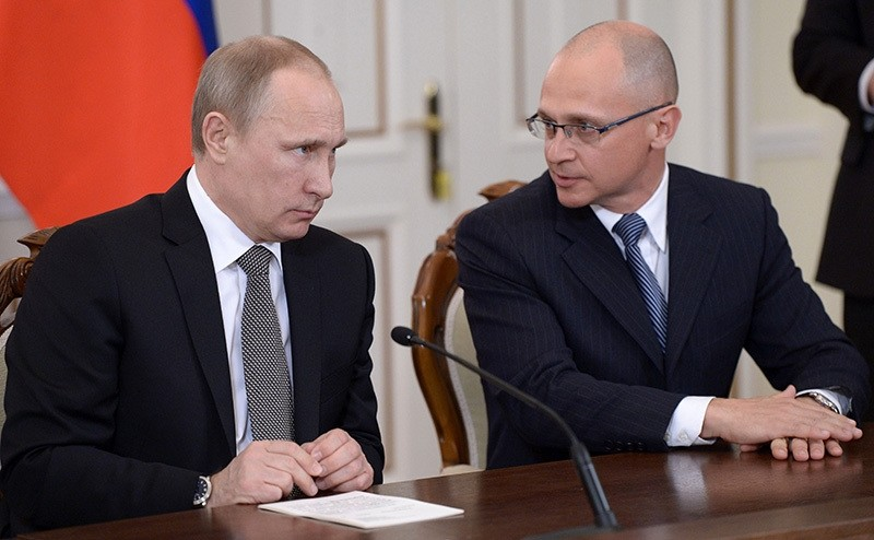 In this Tuesday, Jan. 14, 2014 file pool photo Russian President Vladimir Putin, left, speaks with Chief of Russia's State Nuclear Corporation Rosatom Sergei Kiriyenko (AP Photo)