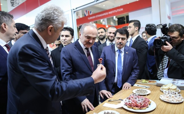 Minister of Science, Industry and Technology, Faruk Özlü, (second from the left), visits the stands in the exhibition area at the World Halal Summit in Istanbul.
