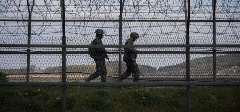 NORTH AND SOUTH KOREAN TROOPS EXCHANGE FIRE ALONG BORDER