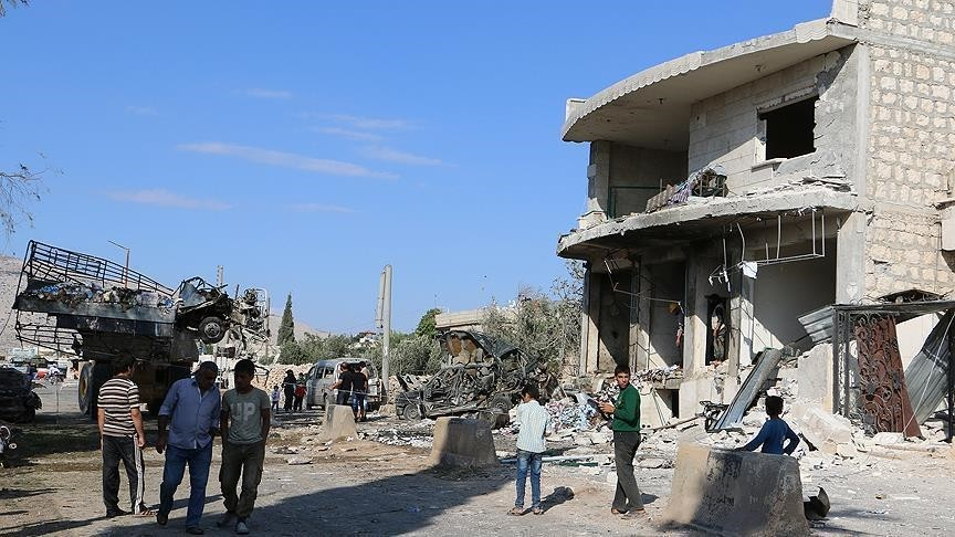 Syrian civilians walk in an area hit by Russian air strikes on Saturday, October 15, 2016. (AA Photo)