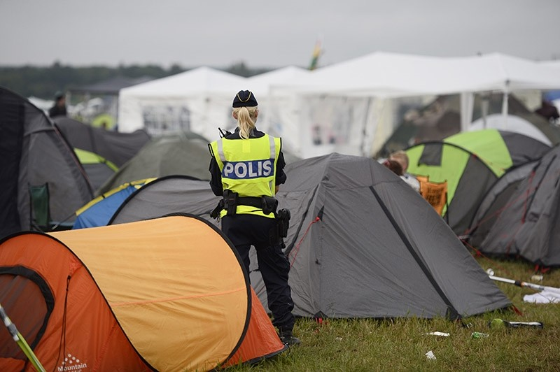 Swedish police officer stands guard at camp site. (AP File Photo)