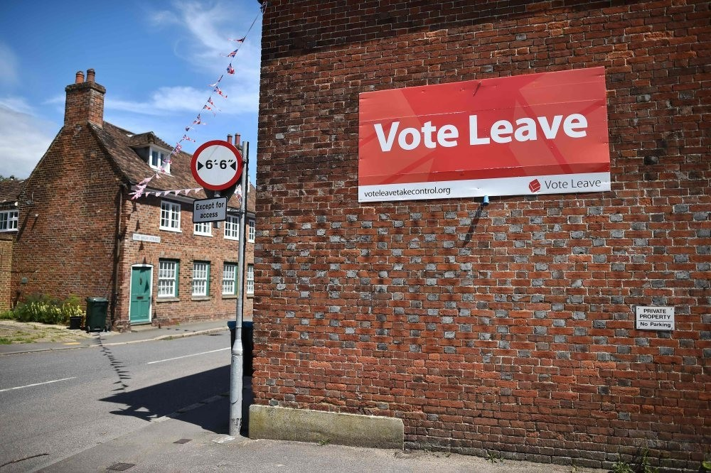 A u2018Vote Leaveu2019 sign is seen on the side of a building in Charing on June 16, 2016 urging people to vote for Brexit in the upcoming EU referendum.