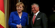 Merkel pledges $100M loan for troubled Jordan