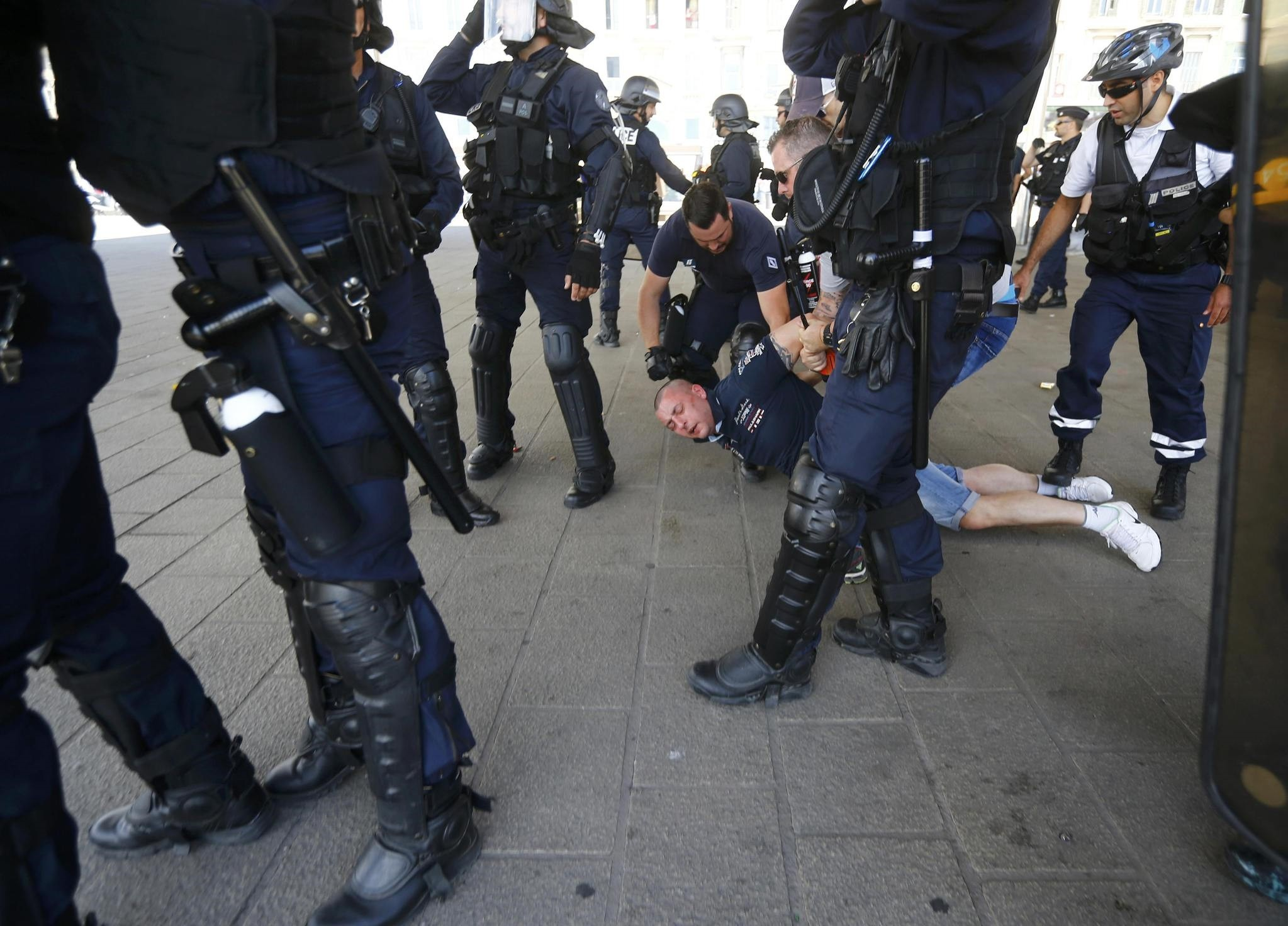A Poland fan is detained by police at the old port of Marseille, France. (Reuters Photo)