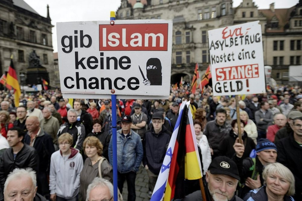 A demonstrator holds a sign that says: ,Give no chance to Islam, at a rally organized by pegida before elections in Dresden on June 7.