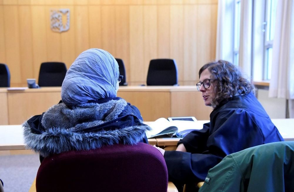 A Syrian refugee waits for an appeal hearing to begin in a hearing room at the Higher Administrative Court (OVG) in Schleswig, Germany, Nov. 23.