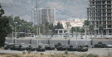 Turkey amasses dozens of tanks along its border with Syria
