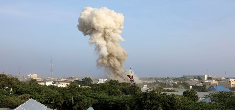 4 CAR BOMBS EXPLODE BY HOTEL IN SOMALIAS CAPITAL; 20 DEAD