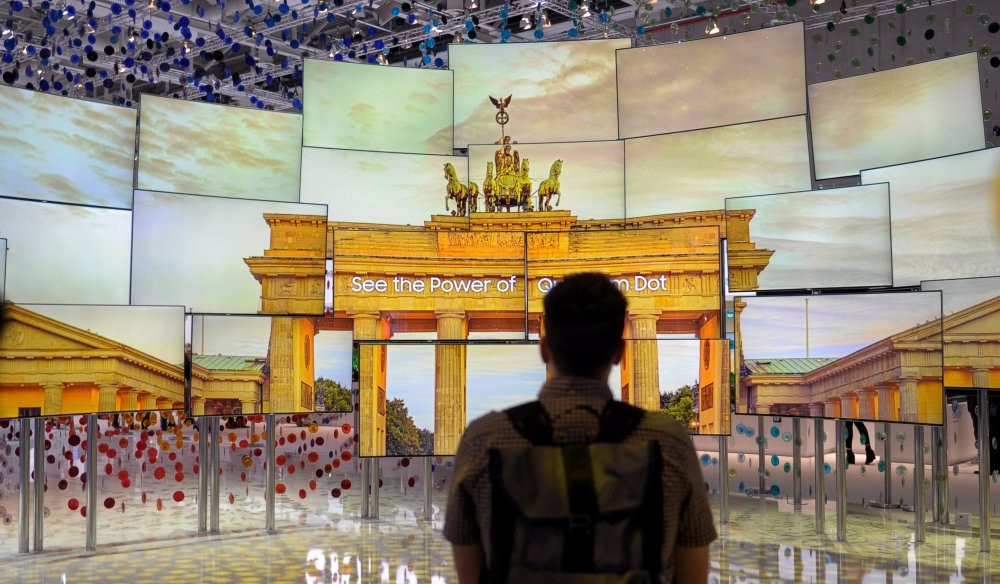 A visitor looks at screens at the IFA Electronics show in Berlin.