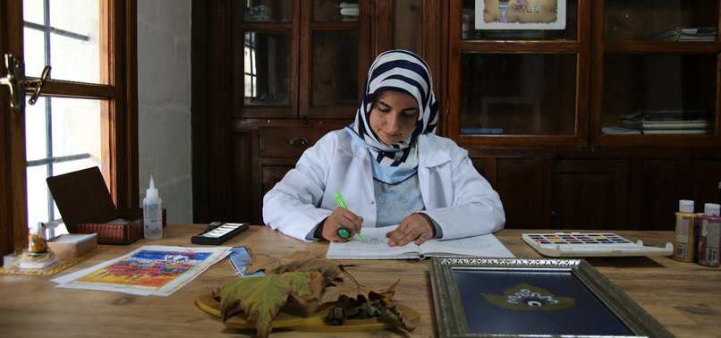 TURKISH CALLIGRAPHER DECORATES DELICATE DRIED LEAVES