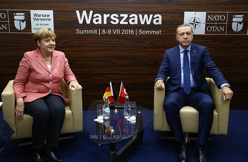 German Chancellor Angela Merkel meets President Recep Tayyip Erdou011fan in Warsaw, Polan during NATO summit on July8-9 IHA Photo