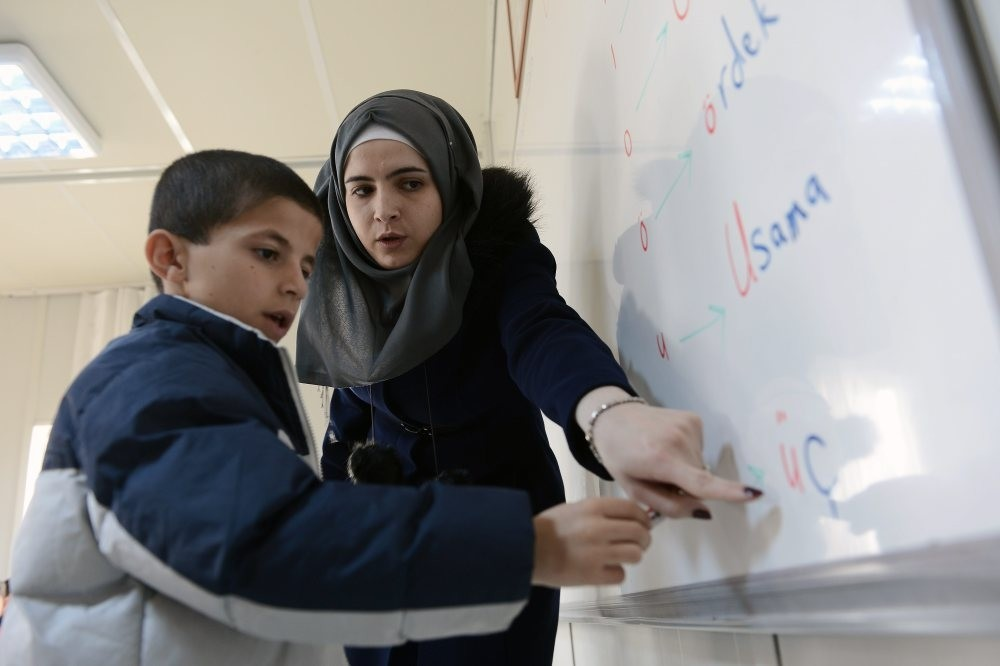 A Syrian teacher with her student at a refugee camp in the city of Malatya.