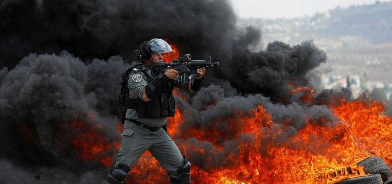 DOZENS OF PALESTINIAN DEMONSTRATORS INJURED BY ISRAELI FORCES DURING A MARCH IN WEST BANK