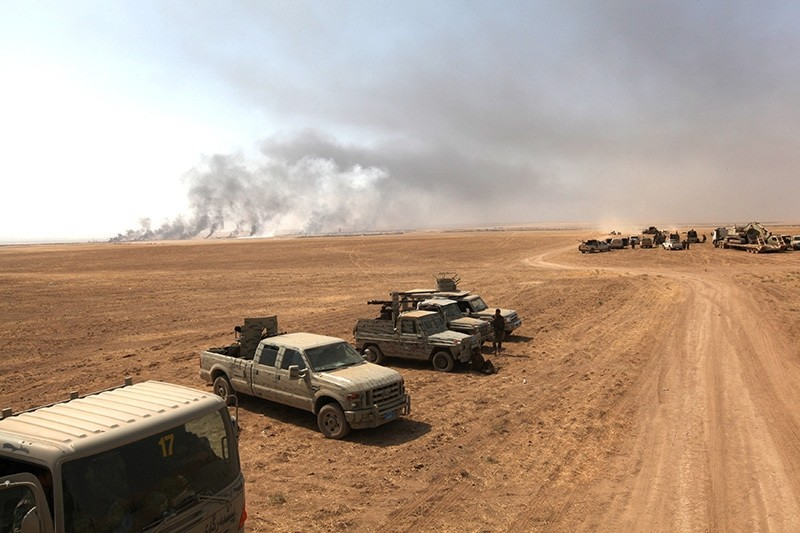 Military vehicles of the Kurdish Peshmerga forces are seen on the southeast of Mosul , Iraq, August 14, 2016. (Reuters Photo)
